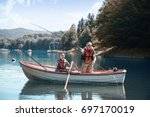 two men relaxing and fishing  | Shutterstock . vector #697170019