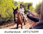 young tourist couple horseback... | Shutterstock . vector #697174399