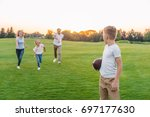 happy grandparents playing... | Shutterstock . vector #697177630