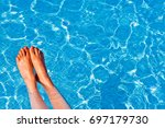 swimming pool with blue tiles ... | Shutterstock . vector #697179730