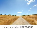 Gravel Road Through Hilly...