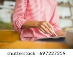 happy women checking order... | Shutterstock . vector #697227259