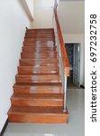 view of elegant glossy wooden... | Shutterstock . vector #697232758