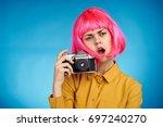 beautiful female photographer... | Shutterstock . vector #697240270