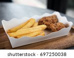 closeup image of french fries... | Shutterstock . vector #697250038