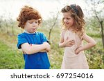 little boy and girl in blooming ... | Shutterstock . vector #697254016