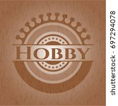 hobby badge with wood background   Shutterstock .eps vector #697294078