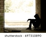 silhouette of  lonely teenager... | Shutterstock . vector #697310890