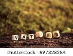 word nature made with wooden... | Shutterstock . vector #697328284