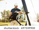young male golfer looking at a... | Shutterstock . vector #697339900
