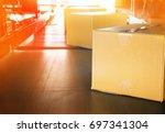 packages boxes on conveyor belt ... | Shutterstock . vector #697341304