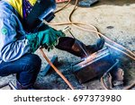 welding workers who are working ... | Shutterstock . vector #697373980
