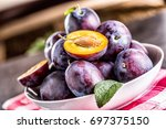 plums. fresh juicy plums in a... | Shutterstock . vector #697375150