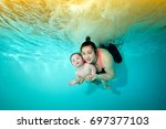 little boy and mother hug and... | Shutterstock . vector #697377103