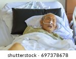 senior adult asia man lying... | Shutterstock . vector #697378678