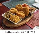 Small photo of Brazilian typical food Bahia - Acaraje with Vatapa and Fried Shrimp