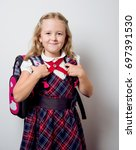 child in a school uniform with... | Shutterstock . vector #697391530