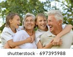 grandparents with grandsons... | Shutterstock . vector #697395988