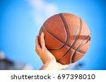 man holding a basketball | Shutterstock . vector #697398010