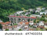 train crossing old viaduct in... | Shutterstock . vector #697403356
