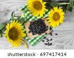 sunflower seeds and oil | Shutterstock . vector #697417414