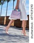 beautiful slender legs tanned... | Shutterstock . vector #697419190