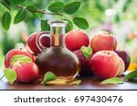 red apple and juice or cider on ... | Shutterstock . vector #697430476