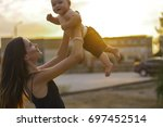 mother with little son. a young ... | Shutterstock . vector #697452514