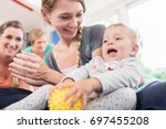 mum and her baby child in... | Shutterstock . vector #697455208