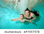 mom with little son swimming... | Shutterstock . vector #697457578