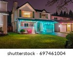house decorated and lighted for ... | Shutterstock . vector #697461004