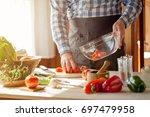 male cooking healthy salad | Shutterstock . vector #697479958