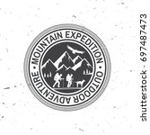 mountain expedition badge.... | Shutterstock .eps vector #697487473