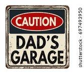 caution dad's garage vintage... | Shutterstock .eps vector #697493950