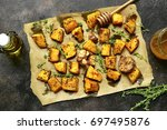 oven baked pumpkin slices with... | Shutterstock . vector #697495876