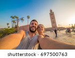 happy smiling tourists take... | Shutterstock . vector #697500763