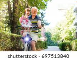 Senior Man Riding Bicycle With...