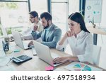 colleagues are concentrated on... | Shutterstock . vector #697518934