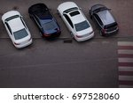 cars in the parking lot. view... | Shutterstock . vector #697528060