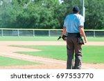 umpire standing on a baseball...   Shutterstock . vector #697553770