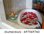 Wide Shot Of A White Bathtub...