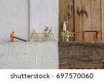 miniature figures working in... | Shutterstock . vector #697570060