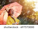 happy funny child with red... | Shutterstock . vector #697573000
