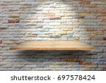 wooden plank shelves and brick... | Shutterstock . vector #697578424
