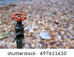a water valve for watering the... | Shutterstock . vector #697611610
