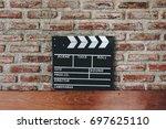 movie clapper board against a... | Shutterstock . vector #697625110