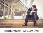 stressed business man sitting... | Shutterstock . vector #697625290