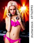 sexy blonde dj girl  in the club - stock photo