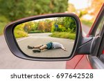 rearview mirror with a man hit... | Shutterstock . vector #697642528