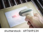 worker handling barcode scanner ... | Shutterstock . vector #697649134